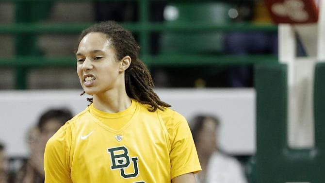 Baylor 's Brittney Griner (42) grins after scoring against Texas in the first half of an NCAA college basketball game Saturday, Feb. 23, 2013, in Waco, Texas. (AP Photo/Tony Gutierrez)