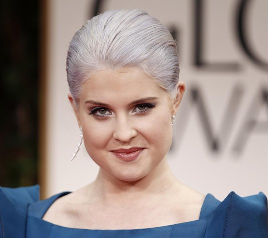 FILE - In this Jan. 15, 2012 file photo, TV personality Kelly Osbourne arrives at the 69th Annual Golden Globe Awards in Los Angeles. Gray heads have been popping up on runways and red carpets, on models and young celebrities for months. There&#39;s Lady Gaga and Kelly Osbourne _ via dye _ and Hollywood royalty like Oscar-winning British actress Helen Mirren. (AP Photo/Matt Sayles, file)