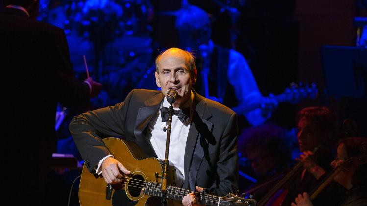 Singer James Taylor performs during the Rainforest Fund's 25th anniversary benefit concert in New York