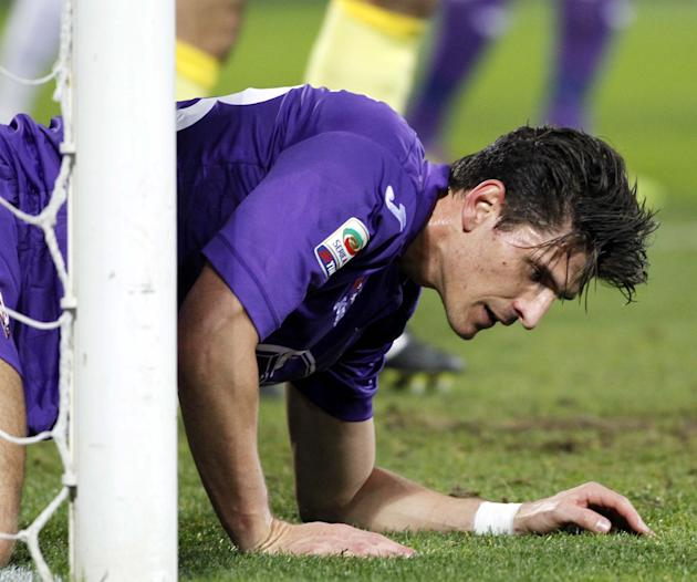 Fiorentina's Mario Gomez gets up from the ground during a Serie A soccer match between Fiorentina and Inter Milan, at the Artemio Franchi stadium in Florence, Italy, Saturday, Feb. 15, 2014