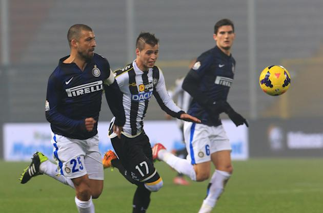 Inter Milan's Walter Samuel, left, and Udinese's Alonso Lopez, fight for the ball the ball during an Italian Cup soccer match, between Udinese and Inter at the Friuli Stadium in Udine, Italy,