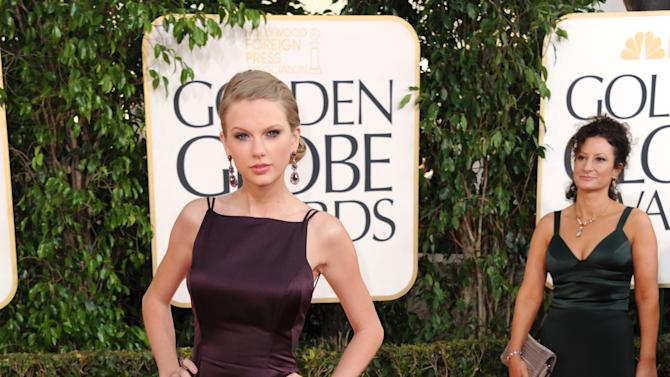 Singer Taylor Swift arrives at the 70th Annual Golden Globe Awards at the Beverly Hilton Hotel on Sunday Jan. 13, 2013, in Beverly Hills, Calif. (Photo by Jordan Strauss/Invision/AP)
