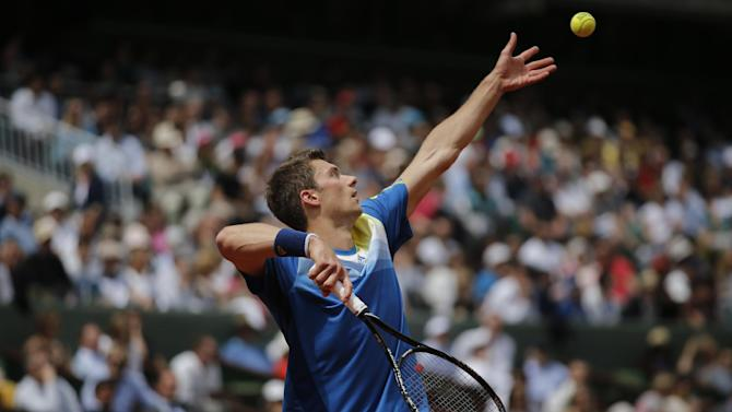 Germany's Daniel Brands returns against Spain's Rafael Nadal in their first round match of the French Open tennis tournament, at Roland Garros stadium in Paris, Monday, May 27, 2013. (AP Photo/Christophe Ena)