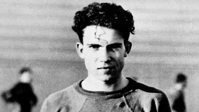 """FILE - In this circa 1930's file photo Richard Nixon is shown as a member of the Whittier College football squad in Whittier, Calif. Years later as President Richard Nixon, he declared himself for pro football """"all the way"""", and told his attorney general to offer the NFL league a quid pro quo: Televise home playoff games, and the president will prevent legislation requiring regular-season home games to be aired as well. NFL Commissioner Pete Rozelle turned him down. (AP Photo/File)"""