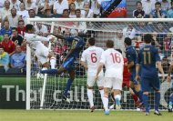 England's Lescott scores apst France's Diarra during their Group D Euro 2012 match at Donbass Arena in Donetsk