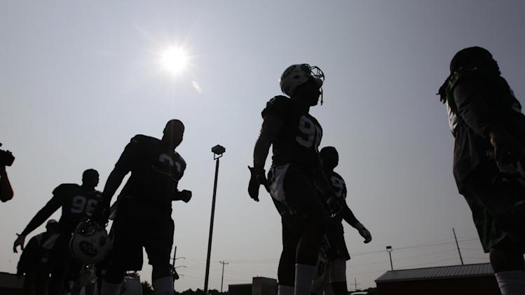 New York Jets defensive linemen Damon Harrison, right, Quinton Coples, second from right, Sheldon Richardson, second from left, and Muhammad Wilkerson, left, walk to practice during their NFL football training camp Friday, July 25, 2014, in Cortland, N.Y.  (AP Photo)