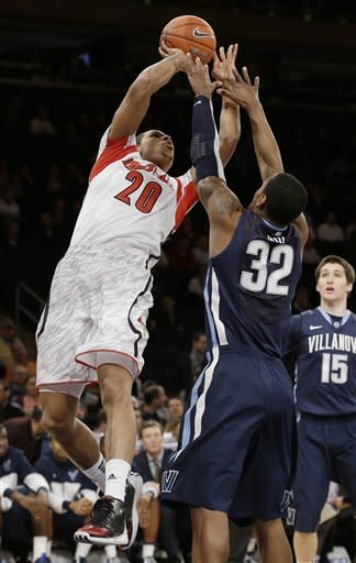 Louisville beats Villanova to reach Big East semis