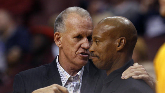 FILE - I(n this Oct. 17, 2012 file photo, Philadelphia 76ers coach Doug Collins, left and Cleveland Cavaliers coach Byron Scott talk before the start of their NBA preseason basketball game in Philadelphia. The Cavaliers have fired Scott after three losing seasons. Collins has resigned after three seasons. (AP Photo H. Rumph Jr., File)
