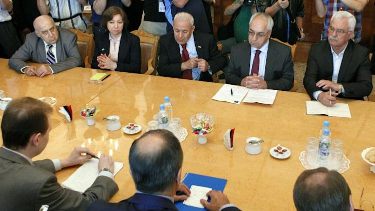 Russian Foreign Minister Sergey Lavrov, foreground center back to camera, meets with a delegation headed by a leader of the Syrian National Council (SNC), Abdulbaset Sieda, second right facing, in Moscow, Russia, Wednesday, July 11, 2012. (AP Photo/Misha Japaridze)