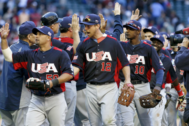 United States' Shane Victorino, left, Ben Zobrist (12) and Adam Jones (10) celebrate a win over Canada after the ninth inning in a World Baseball Classic baseball game on Sunday, March 10, 2013, in Ph