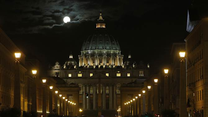 The full moon is seen above the St. Peter's Basilica at the Vatican, early Tuesday, Feb. 26, 2013. Pope Benedict XVI has changed the rules of the conclave that will elect his successor, allowing cardinals to move up the start date if all of them arrive in Rome before the usual 15-day transition between pontificates. Benedict signed a legal document, issued Monday, with some line-by-line changes to the 1996 Vatican law governing the election of a new pope. It is one of his last acts as pope before resigning Thursday. (AP Photo/Dmitry Lovetsky)