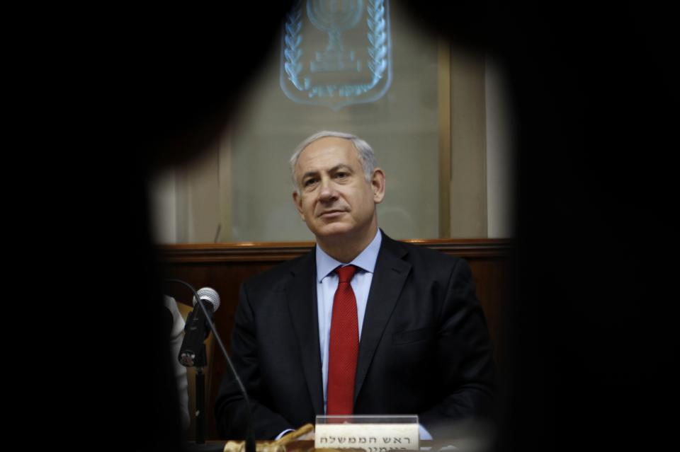 Israel's Prime Minister Benjamin Netanyahu attends the weekly cabinet meeting in Jerusalem, Sunday, June 10, 2012. Netanyahu on Sunday led a chorus of Israeli officials expressing outrage over the bloodshed in Syria, accusing Iran and Lebanese Hezbollah militants of complicity in the carnage there. (AP Photo/Baz Ratner, Pool)