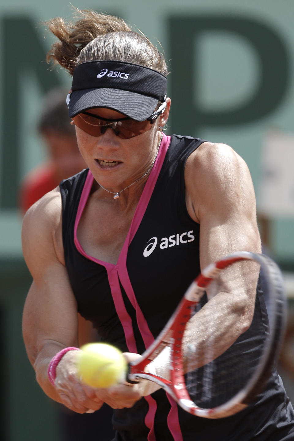 Australia's Samantha Stosur returns the ball to Slovakia's Dominika Cibulkova during their quarterfinal match in the French Open tennis tournament at the Roland Garros stadium in Paris, Tuesday, June 5, 2012. Stosur won 6-4, 6-1. (AP Photo/Michel Spingler)