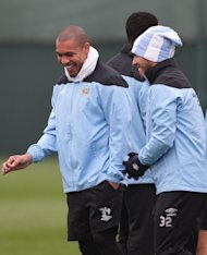 Nigel de Jong (left) and Carlos Tevez