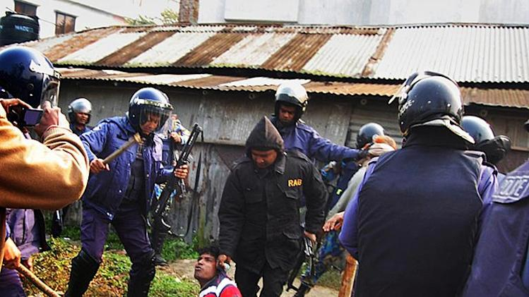 Bangladeshi police detain a suspect following an attack on a polling station in the northern town of Bogra on January 5, 2014