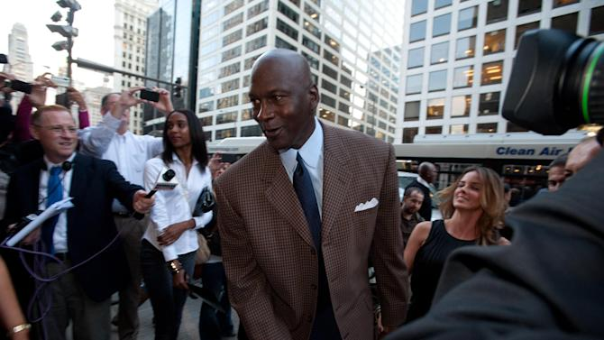COMMERCIAL IMAGE - In this photograph taken by AP Images for Michael Jordan's Steak House, Michael Jordan and Yvette Prieto arrive at the Grand Opening Celebration of Michael Jordan's Steak House in Chicago, Thursday, Sept. 22, 2011. (Peter Barreras/AP Images for Michael Jordan's Steak House)
