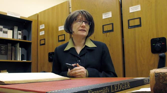 In this Tuesday, March 26, 2013 photo, Elizabeth Sudduth, director of the Ernest F. Hollings Library and Rare Books Collection at the University of South Carolina, talks about a ledger owned by author F. Scott Fitzgerald, in Columbia, S.C. The university has digitized the ledger and put it online for scholars. (AP Photo/Jeffrey Collins)