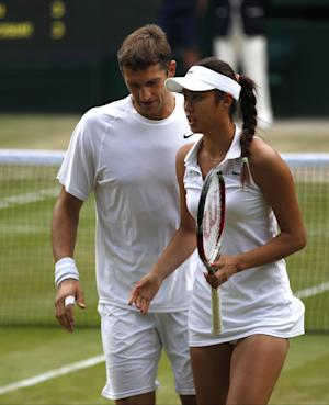 Zimonjic, Stosur win Wimbledon mixed doubles