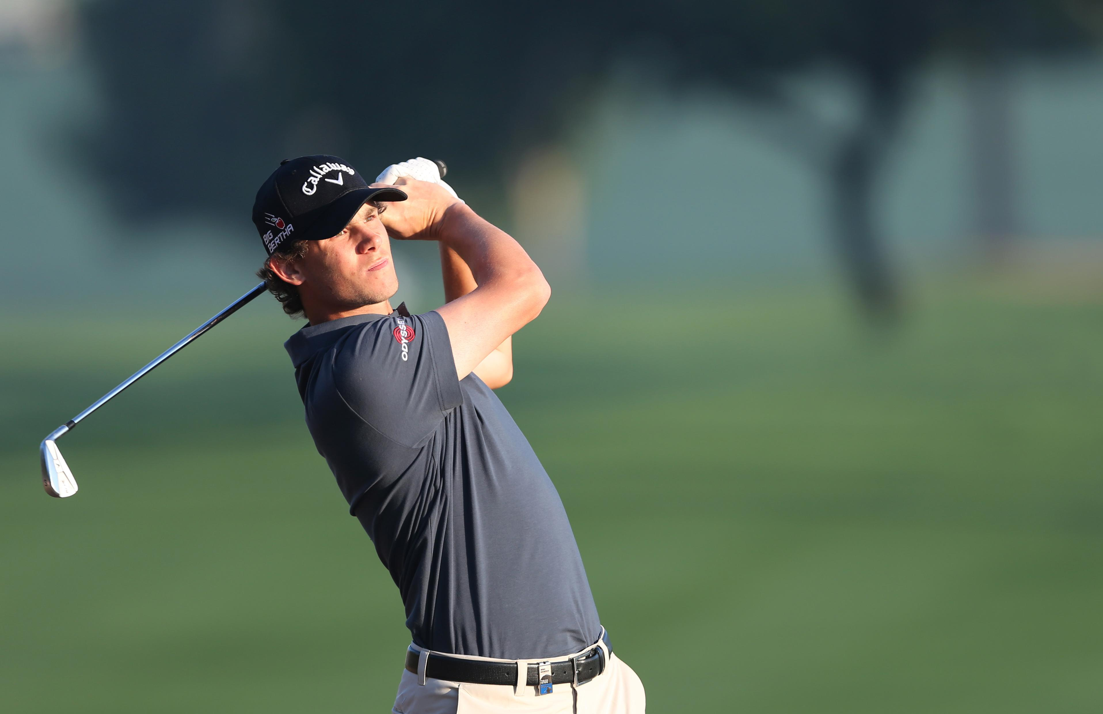 Nic Henning equals course record to lead Joburg Open
