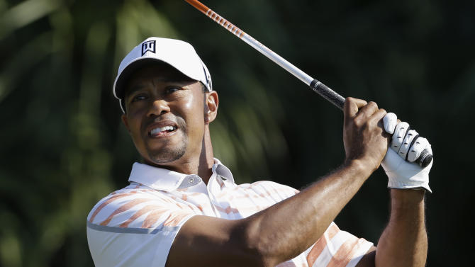 Tiger Woods hits from the 12th tee during the second round of the Cadillac Championship golf tournament Friday, March 8, 2013, in Doral, Fla. (AP Photo/Tiger Woods)