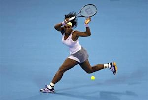Williams returns a shot against Jankovic at the China Open tennis tournament in Beijing