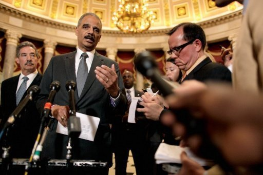 <p>US Attorney General Eric Holder talks to reporters after meeting with House Oversight and Government Reform Committee Chairman Darrell Issa in the US Captiol June 19. In an unprecedented censure vote, the US House of Representatives found him in criminal contempt, paving the way for legal action over the blocking of a probe into a botched gun-running operation.</p>