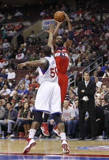 Holiday, Nick Young lead 76ers over Wizards