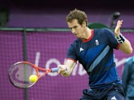 Great Britain's Andy Murray returns the ball to Finland's Jarkko Nieminen during their men's single tennis second round match at the All England Tennis Club in Wimbledon, southwest London, during the London 2012 Olympic Games. Murray won the match