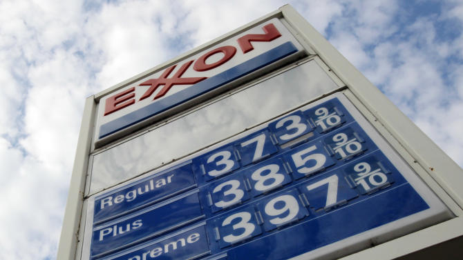 FILE - This Feb. 27, 2012, file photo shows gas prices at a Pittsburgh Exxon mini-mart. Exxon Mobil's fourth-quarter profit fell 16 percent as the company produced slightly less oil and gas and its refining business weakened, the company announced on Thursday, Jan. 30, 2014. (AP Photo/Gene J. Puskar, File)
