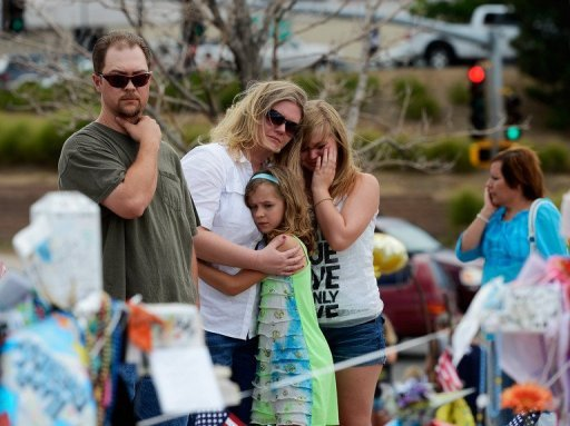 A family mourns the shooting victims in Aurora