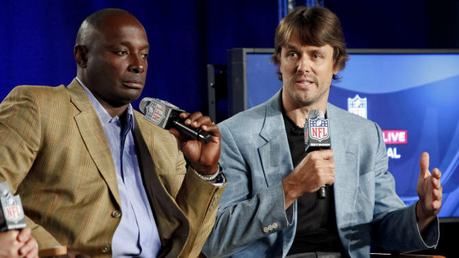 Former NFL player Sterling Sharpe and Jake Plummer are seen during the DirecTV NFL Fantasy Week on Thursday, Aug. 23, 2012 at the Best Buy theatre in Times Square in New York. (Photo by Brian Ach/AP Images for NFL)