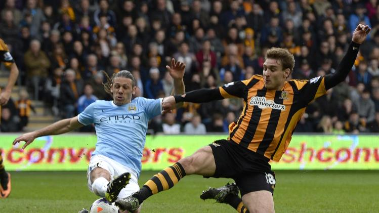 Manchester City's Demachelis challenges Hull City's Jelavic during their English Premier League soccer match in Hull
