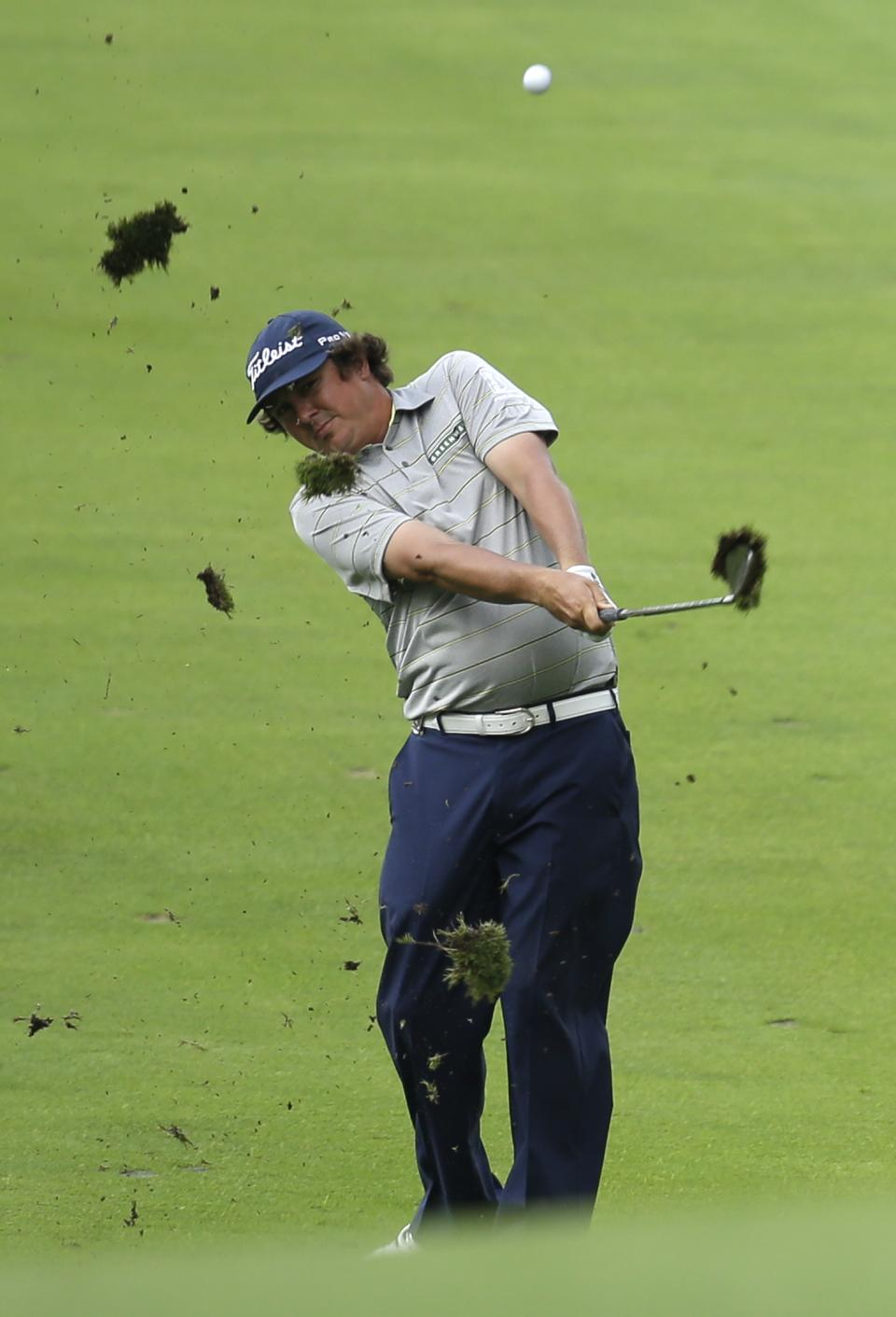 Jason Dufner hits from the fairway on the 14th hole during the second round of the PGA Championship golf tournament at Oak Hill Country Club, Friday, Aug. 9, 2013, in Pittsford, N.Y. (AP Photo/Charlie Neibergall)
