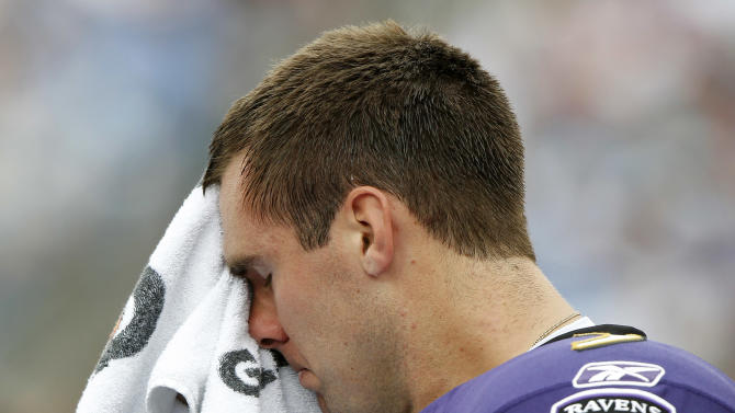 Baltimore Ravens quarterback Joe Flacco wipes his face in the second quarter of an NFL football game against the Tennessee Titans on Sunday, Sept. 18, 2011, in Nashville, Tenn. The Titans won 26-13. (AP Photo/Wade Payne)