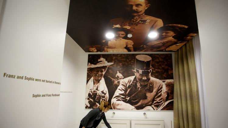 Hotel manager Emela Burdzovic arranges a room, whose ceiling bears a picture of Austrian Archduke Franz Ferdinand, at the Franz Ferdinand hostel in Sarajevo