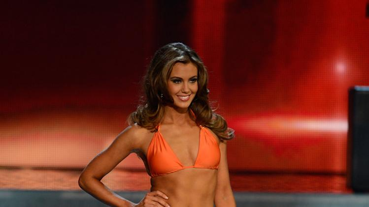 Miss Connecticut Erin Brady walks the runway during the swimsuit competition of the Miss USA 2013 pageant, Sunday, June 16, 2013, in Las Vegas. Erin Brady of South Glastonbury, Conn., won the beauty pageant at the Planet Hollywood hotel-casino after strutting in a white sparkly gown and answering a question about the U.S. Supreme Court's decision upholding widespread DNA tests.  (AP Photo/Jeff Bottari)
