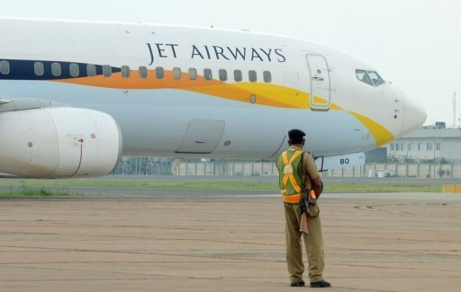&lt;p&gt;An Indian security official and a Jet Airways aircraft at Indira Gandhi International Airport in New Delhi on September 12, 2012. Loss-making private Indian carrier Jet Airways says it was in talks with Etihad Airways about selling a stake to the Abu Dhabi-based airline.&lt;/p&gt;