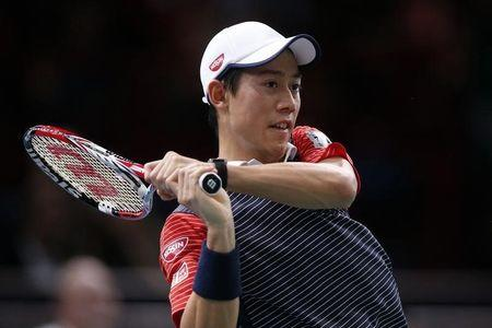 Nishikori of Japan returns a shot during his men's singles quarter-final tennis match against Ferrer of Spain at the Paris Masters tennis tournament at the Bercy sports hall in Paris