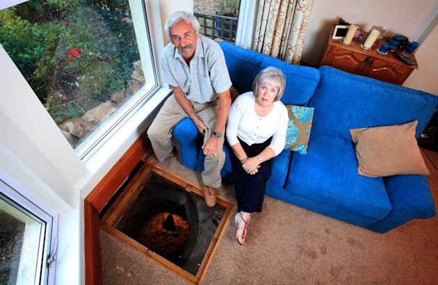 Plymouth couple who found 33ft well in their living room  Picture: SWNS