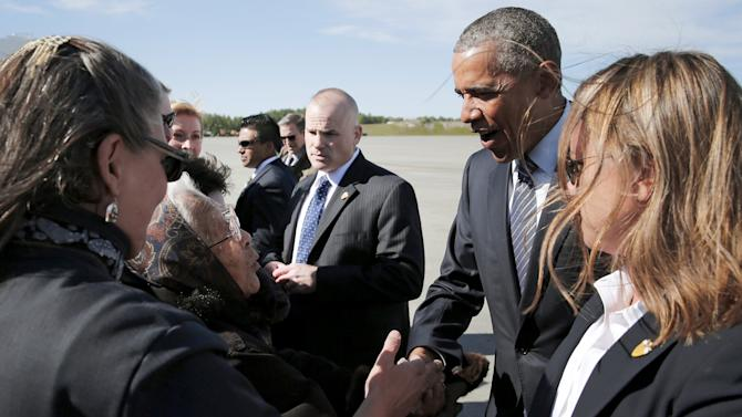 Author and founding member of the Fairbanks Native Association Carlo greets U.S. President Obama after he arrived aboard Air Force One at Elmendorf Air Force Base in Anchorage, Alaska