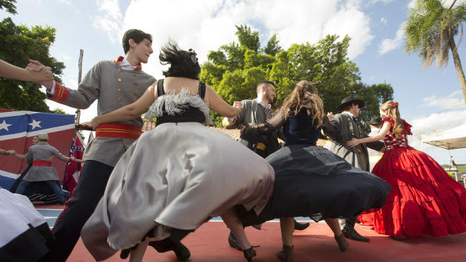 "Descendants of American Southerners Wearing Confederate-era dresses and uniforms dance during a party to celebrate the 150th anniversary of the end of the American Civil War in Santa Barbara d'Oeste, Brazil, Sunday, April 26, 2015. For many of the residents of Santa Barbara d'Oeste and neighboring Americana, in Brazil's southeastern Sao Paulo state, having Confederate ancestry is a point of pride and is celebrated in high style at the annual ""Festa dos Confederados,"" or ""Confederates Party"" in Portuguese. (AP Photo/Andre Penner)"