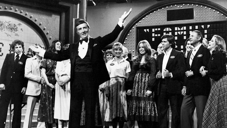 """FILE - In this May 8, 1978 file photo, Richard Dawson, foreground, is in his familiar role as host of """"Family Feud"""" when the casts of ABC's comedy series """"Eight is Enough,"""" """"The Love Boat,"""" """"Soap,"""" and """"Three's Company"""" compete to benefit charity. Dawson, the wisecracking British entertainer who was among the schemers in the 1960s sitcom """"Hogan's Heroes"""" and a decade later began kissing thousands of female contestants as host of the game show """"Family Feud"""" died Saturday, June 2, 2012. He was 79. (AP Photo, File)"""