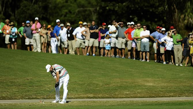Tommy Gainey hits off the 18th fairway during the final round of the McGladrey Classic PGA Tour golf tournament on Sunday, Oct. 21, 2012, in St. Simons Island, Ga. Gainey finished 16 under par to win his first PGA tournament. (AP Photo/Stephen Morton)