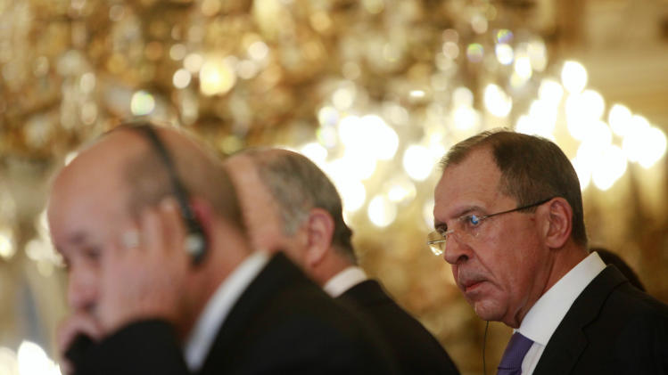 Russian foreign minister Sergei Lavrov, right, attends a news conference at the French foreign ministry, in Paris, Wednesday, Oct. 31 2012. French and Russian ministers are engaged in bilateral cooperation talks. (AP Photo/Thibault Camus)