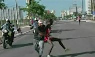 Kenyan Runner Tackled By Race Spectator