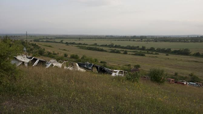 A line of car wreckage, which serves to demarcate the border territory of the breakaway region of South Ossetia and Georgia, is seen near Tskhinvali