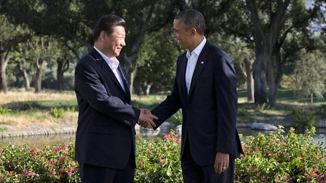 President Barack Obama shakes hands with Chinese President Xi Jinping at the Annenberg Retreat at Sunnylands as they meet for talks Friday, June 7, 2013, in Rancho Mirage, Calif. Seeking a fresh start to a complex relationship, they are retreating to the sprawling desert estate for two days of talks on high-stakes issues, including cybersecurity and North Korea's nuclear threats. (AP Photo/Evan Vucci)