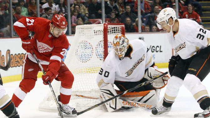 Detroit Red Wings center Tomas Tatar (21), of the Czech Republic, takes a shot against Anaheim Ducks goalie Viktor Fasth (30), of Sweden, and defenseman Toni Lydman (32), of Finland, in the second period of an NHL hockey game on Friday, Feb. 15, 2013, in Detroit. (AP Photo/Duane Burleson)