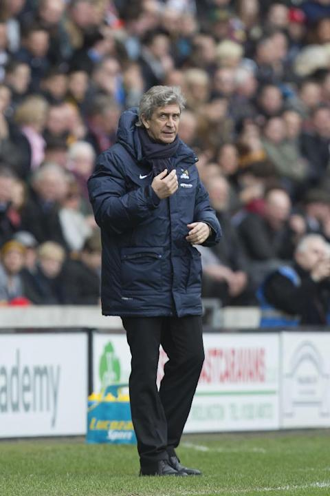 Manchester City's manager Manuel Pellegrini issues instructions during his team's English Premier League soccer match against Hull City at the KC Stadium, Hull, England, Saturday March 15, 201