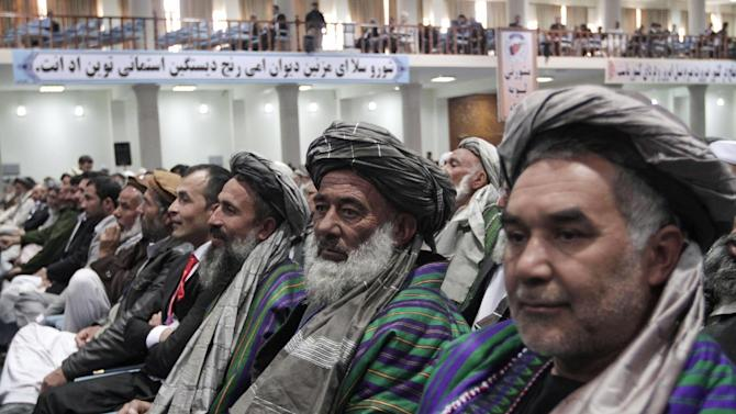 Members of the Afghan Loya Jirga attend a meeting in Kabul, Afghanistan, Thursday, Nov. 21, 2013. Afghan President Hamid Karzai has told a gathering of elders that he supports signing a security deal with the United States if safety and security conditions are met. Karzai spoke as the 2,500-member national consultative council of Afghan elders known as the Loya Jirga started in Kabul on Thursday. The four-day meeting will discuss the bilateral security pact that defines the role of thousands of U.S. troops who will remain after the NATO combat mission ends in 2014. (AP Photo/Rahmat Gul)